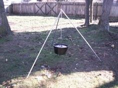 Camping tripod for cooking over fi