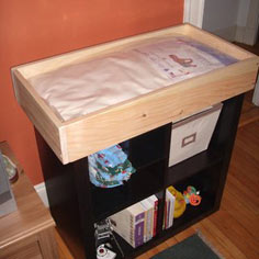 Baby changing tray that fits on top of a bookshelf