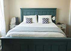 Build a Farmhouse Bed, Calif King | Free and Easy DIY Project and Furniture Plans