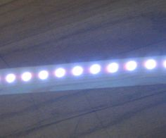 LED light strip in wood housing
