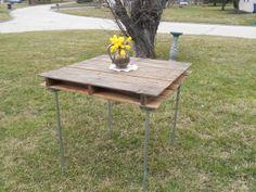 Rustic table made out of a wooden shipping pallet