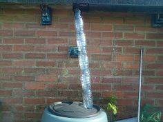 Plastic bottle rainwater down pipe with filter