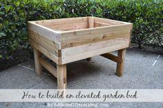 Elevated garden bed table