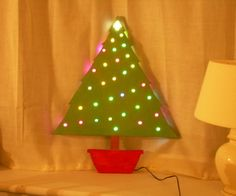 Wooden Christmas tree with colour-changing lights